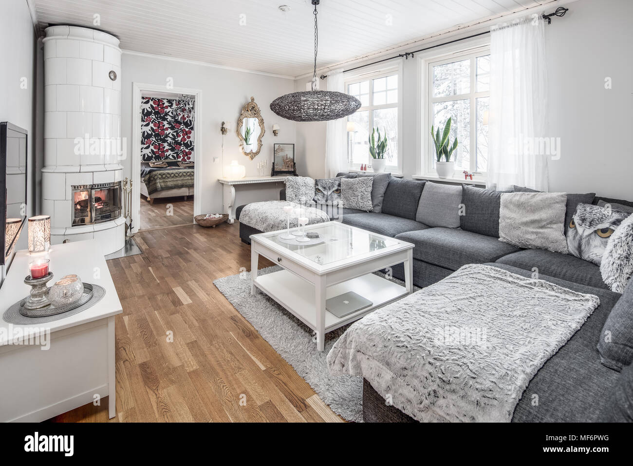 Contemporary Scandinavian Grey And White Living Room With A Hearth And A View To The Bedroom Stock Photo Alamy