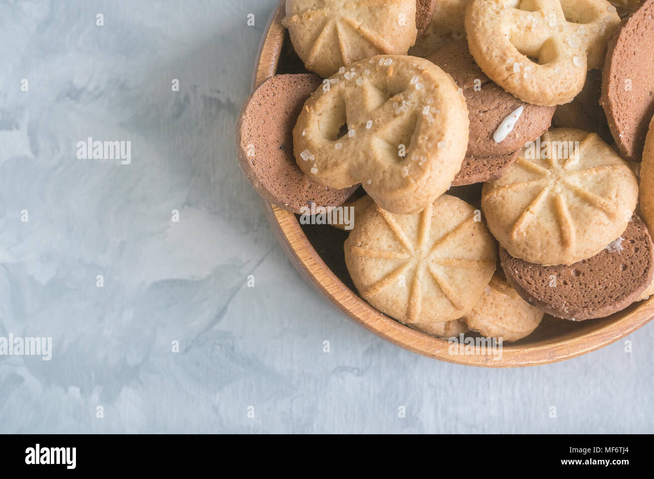 Background with almond and chocolate cookies and on grey vintage table, food concept with copy space, top view. - Stock Image