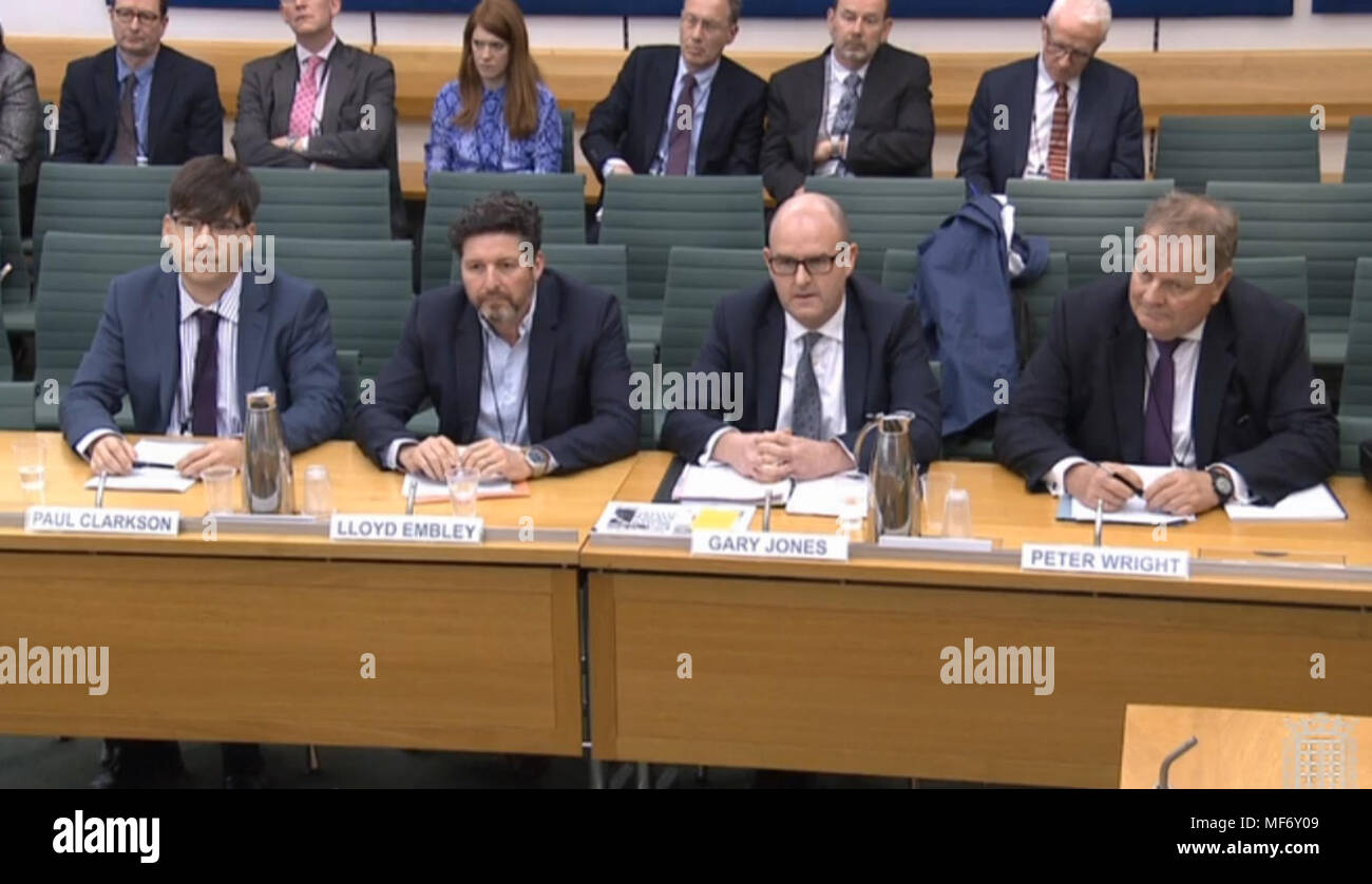 Senior journalists (left to right) Managing Editor The Sun Paul Clarkson, Group Editor-in-Chief Trinity Mirror Lloyd Embley, Editor-in-Chief Daily and Sunday Express Gary Jones and Editor Emeritus Associated Newspapers Peter Wright, giving evidence in front the House of Commons Home Affairs Committee inquiry into hate crime and its violent consequences. - Stock Image