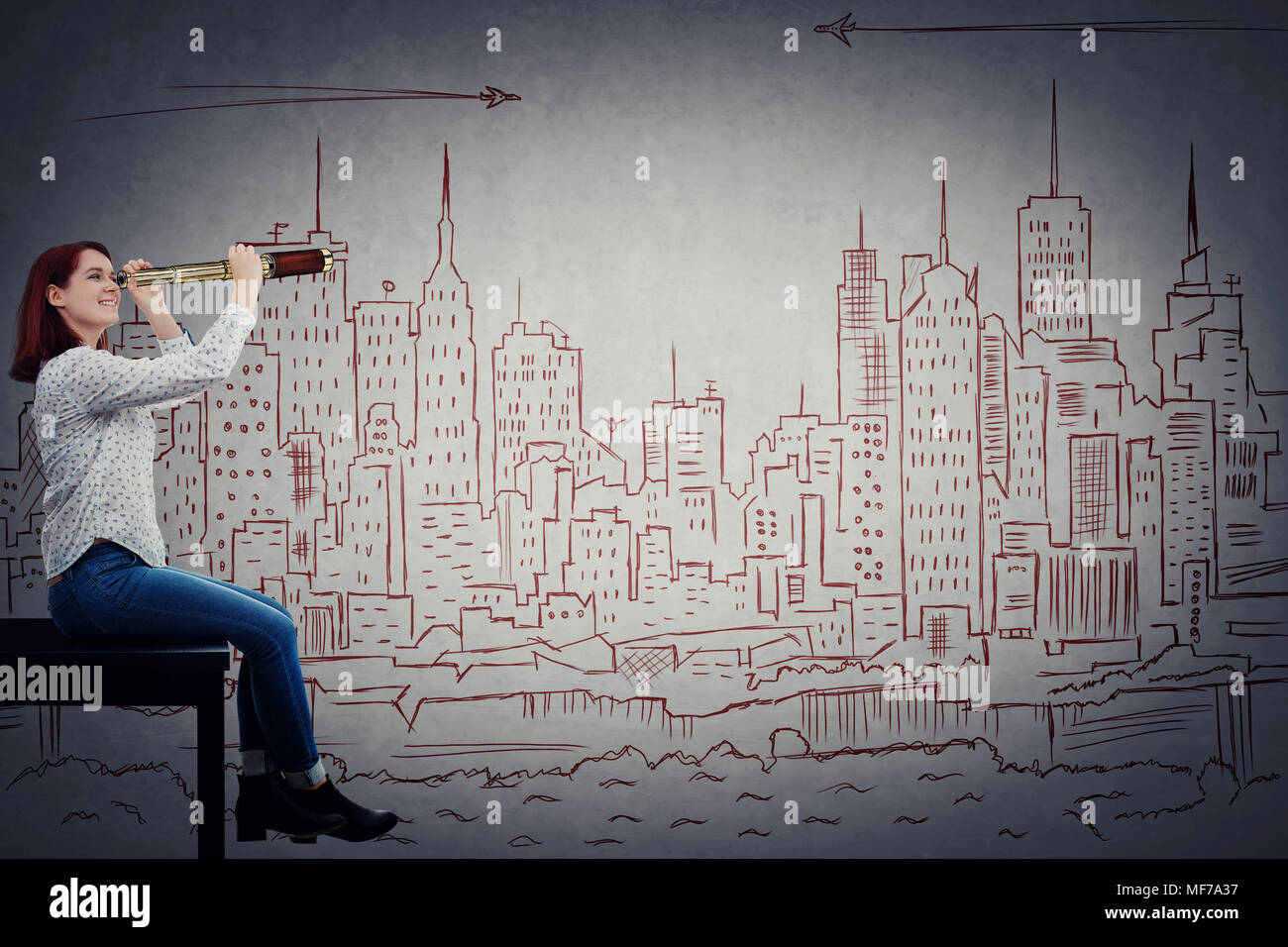 Portrait of positive, young woman looking through a spyglass at an imaginary drawn city, Ready for a new adventure. Business break, dreaming of holida - Stock Image