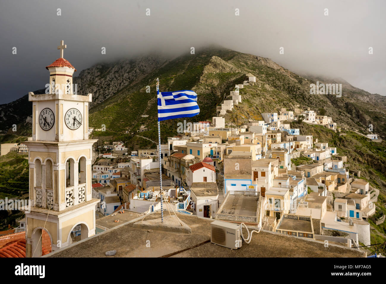 Greece, Aegean Islands, Olympos, Karpathos island, the church and the top of the village with the ruined windmill Stock Photo