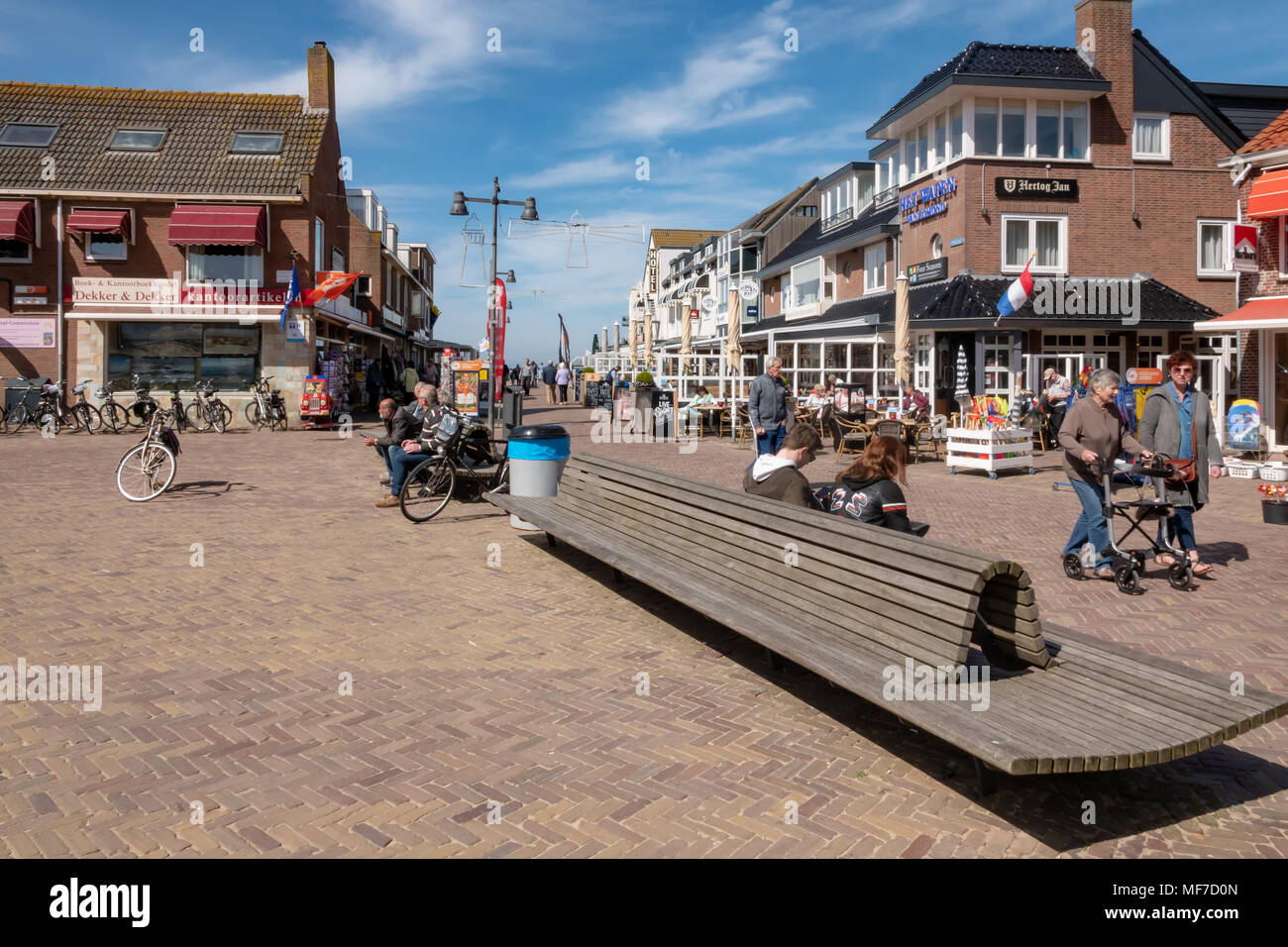 Egmond aan Zee , Noord Holland / The Netherlands - April 24th 2018 : A popular seaside resort on the north west coast of Holland. Tourists enjoying a drink at the local cafe's and restaurants. - Stock Image