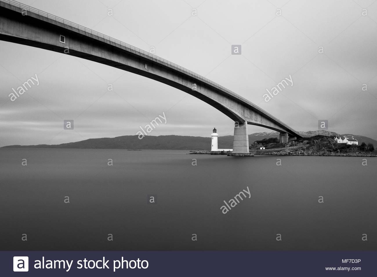Kyleakin Lighthouse on the Isle of Skye in Scotland sits under the Skye Bridge - Stock Image