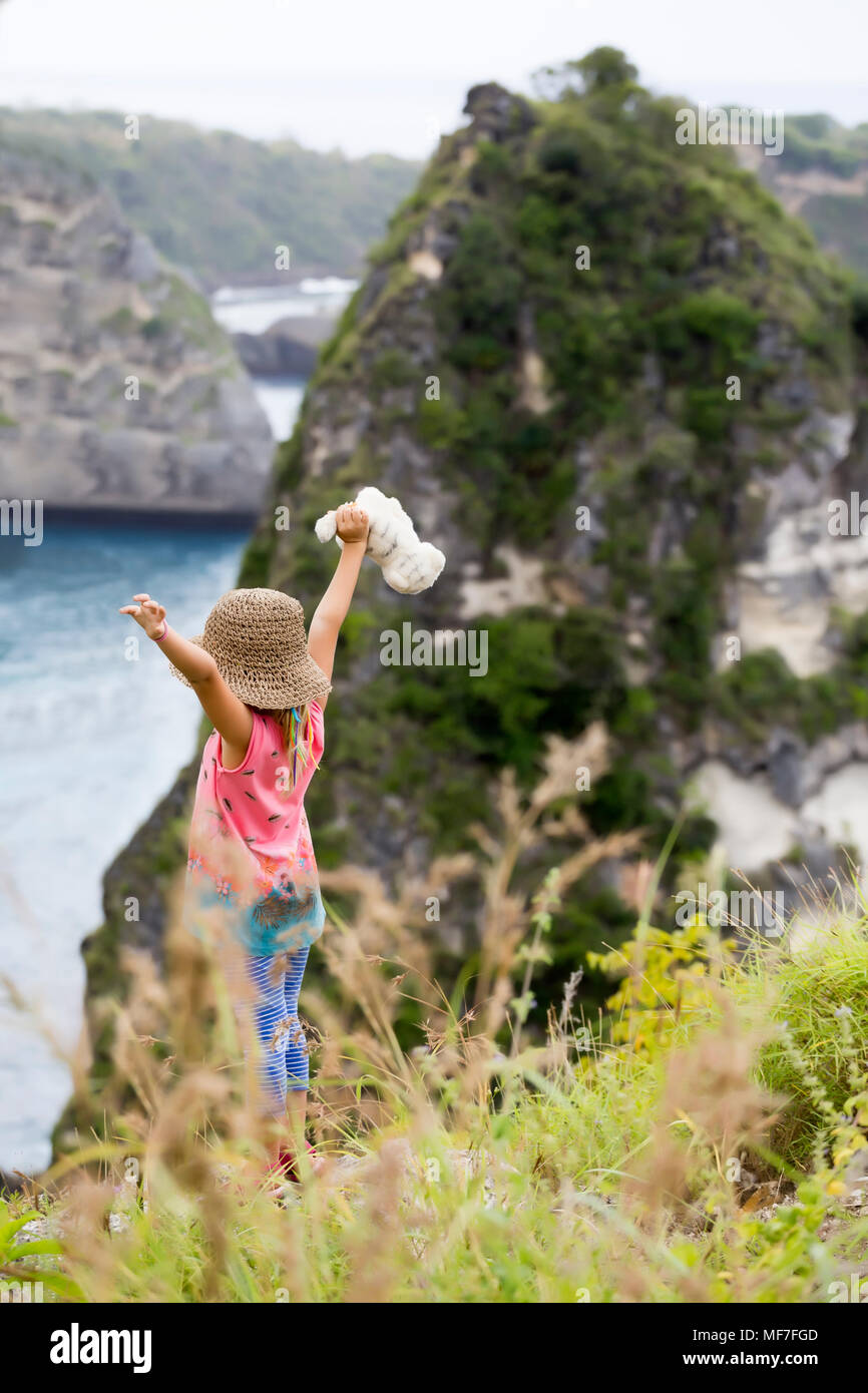 Indonesia, Bali, Nusa Penida island, girl standing on observation point - Stock Image