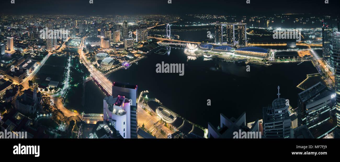 Singapore, Skyline at night with Marina Bay as seen from Alitude Bar Stock Photo