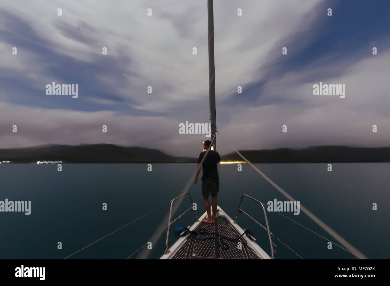 Indonesia, Lombok island, man on deck of a sailing boat at dusk Stock Photo