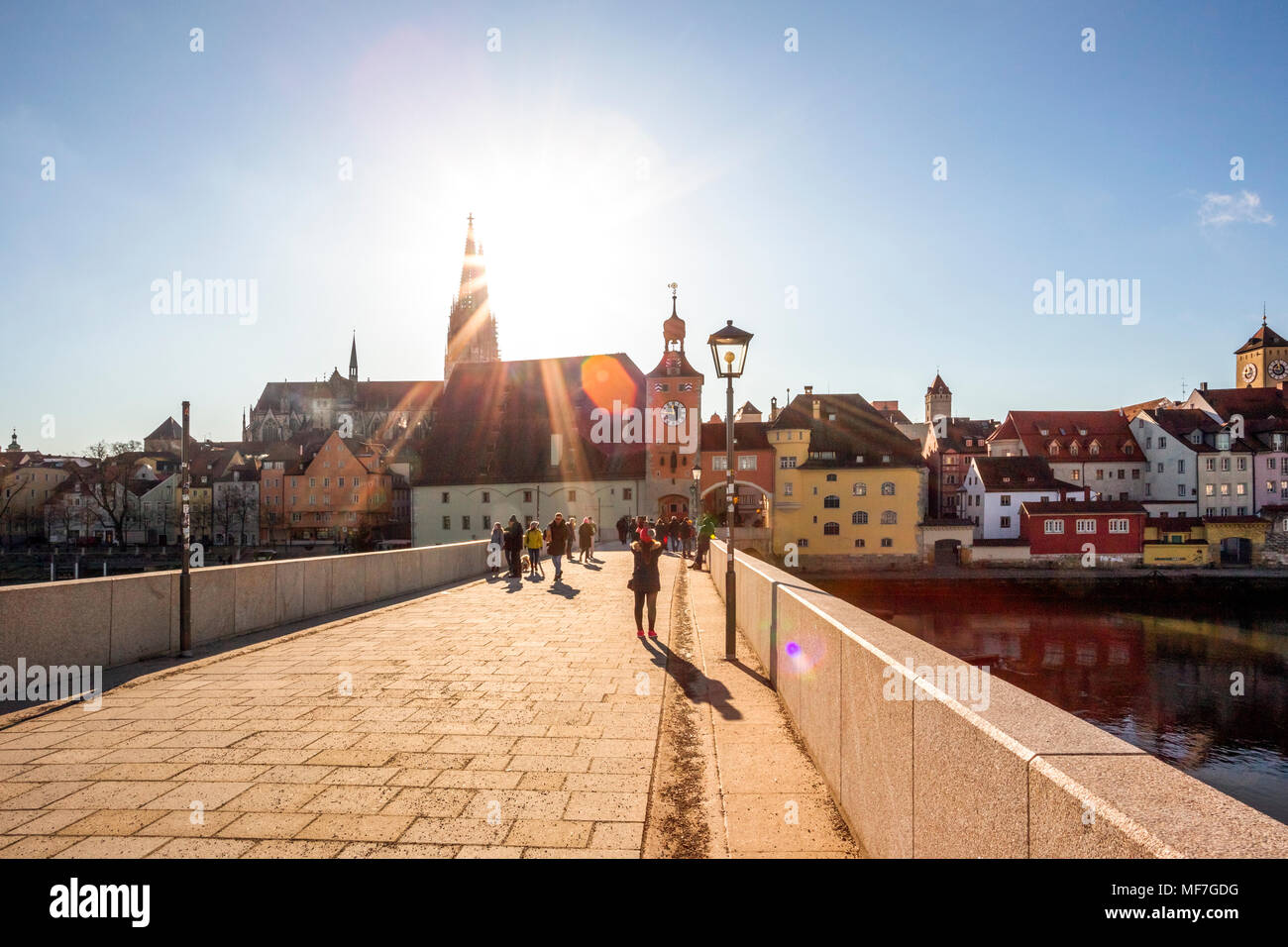 Germany, Regensburg, view to cathedral at the old town with Steinerne Bruecke in the foreground - Stock Image