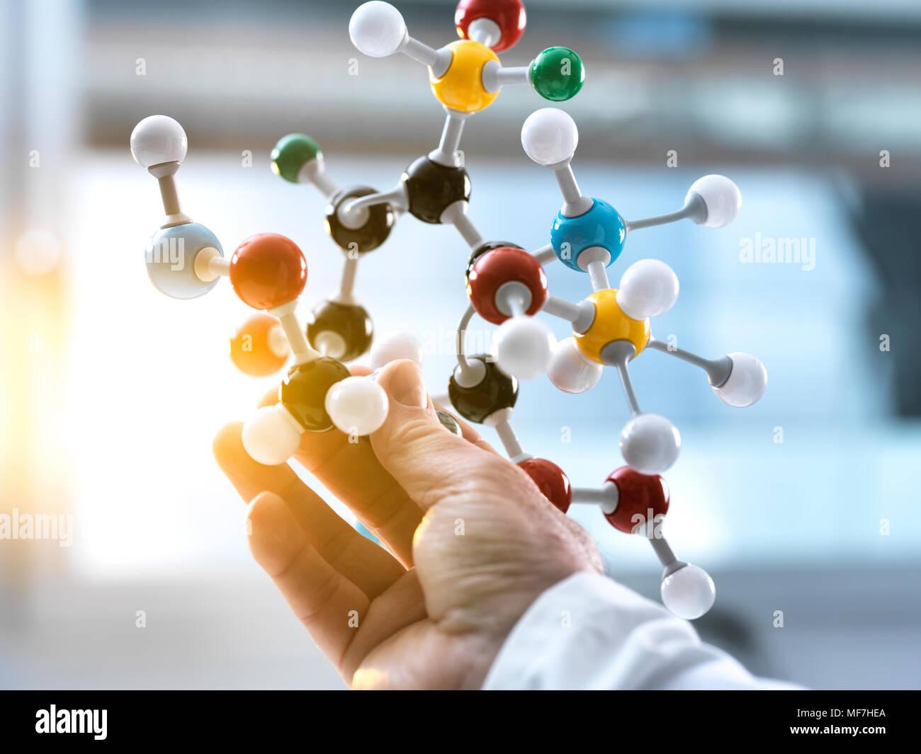 Scientist holding a molecular model - Stock Image
