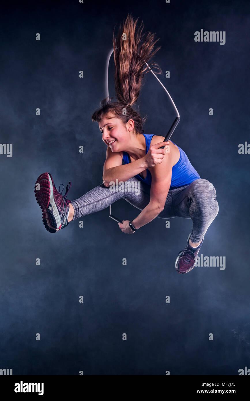 Female teenager rope skipping - Stock Image