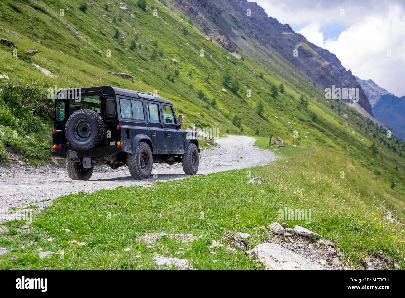 Italy, Piemont, Landrover on gravel road - Stock Image