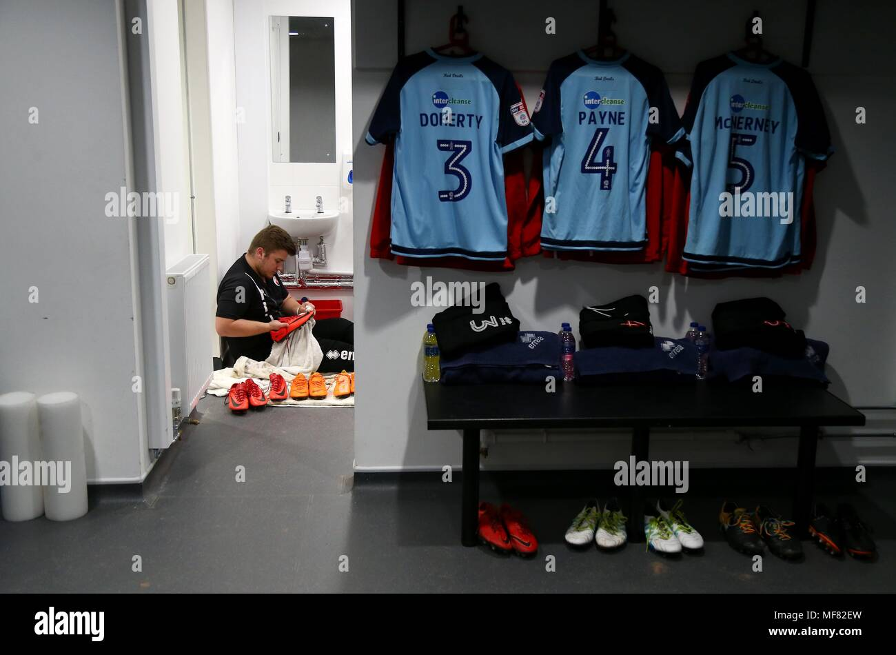 Dave the Crawley Town Kit Man cleans football boots before the Sky Bet League 2 match between Exeter City and Crawley Town at St James Park in Exeter. 21 Apr 2018  EDITORIAL USE ONLY FA Premier League and Football League images are subject to DataCo Licence see www.football-dataco.com - Stock Image