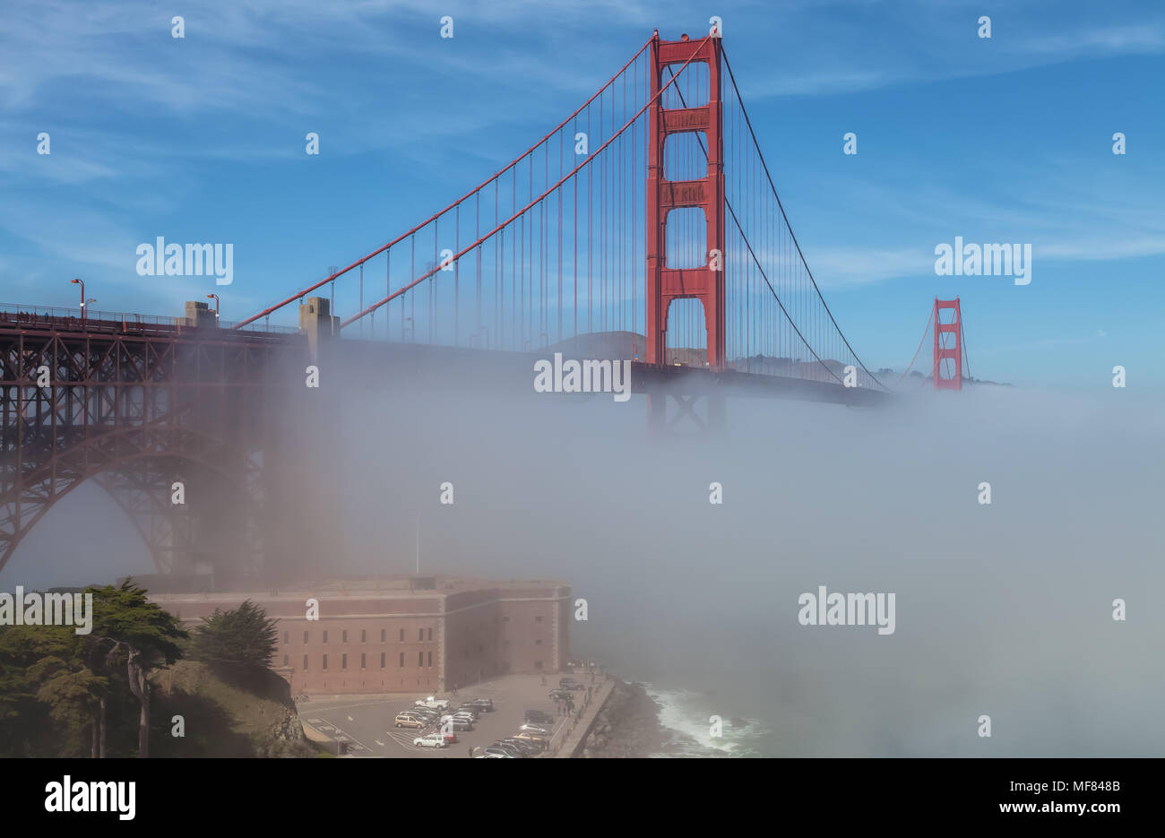 The historic Fort Point at the Golden Gate Bridge amid the dense fog on an early spring morning in San Francisco, California, United States. - Stock Image