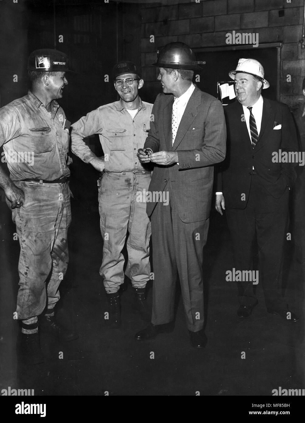 "PC 1788       April 1960 John F. Kennedy, wearing hard hat, talks with miners in West Virginia during the Presidential Primary campaign.  Please credit ""John F. Kennedy Presidential Library and Museum, Boston"" Stock Photo"