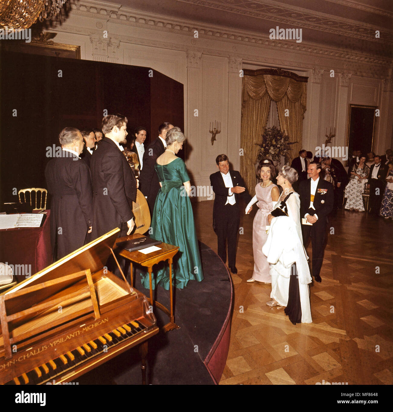 ST-C125-8-63   30 April 1963 President Kennedy, Jackie Kennedy, Grand Duchess Charlotte of Luxembourg, and Grand Duke of Luxembourg Prince Jean approach the stage at the State Dinner in honor of the Grand Duchess, 30 April 1963.  Basil Rathbone gave Elizabethan readings and the Consort Players of New York played music in the East Room.  Photograph by Cecil Stoughton in the John F. Kennedy Presidential Library and Museum, Boston. - Stock Image