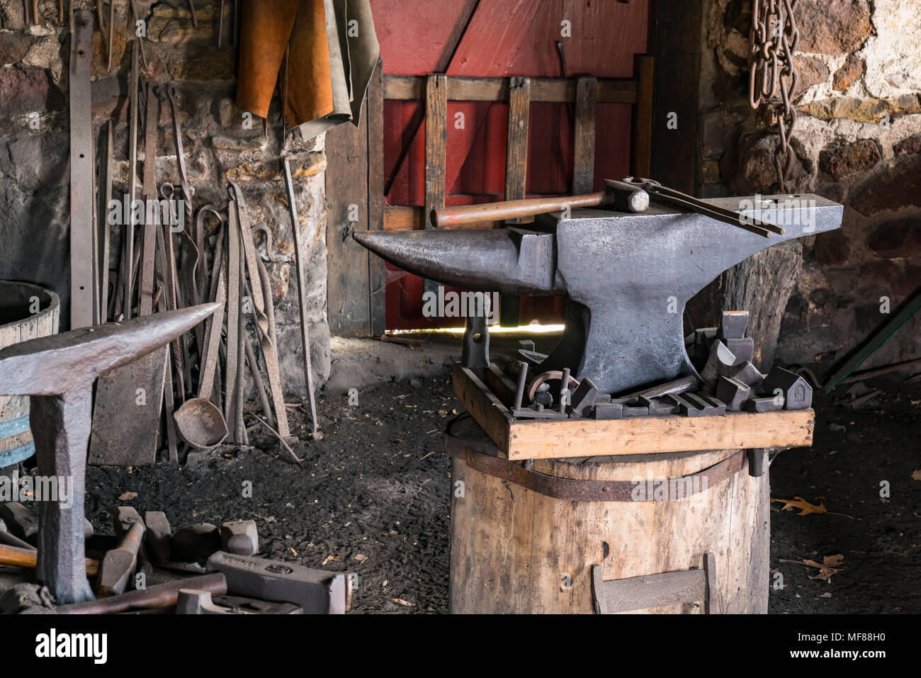 Tools on an Iron Anvil in an old Blacksmiths Shop Stock Photo