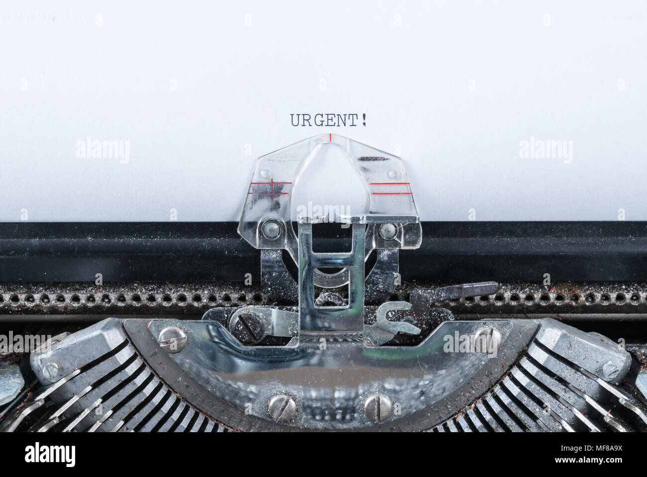 Urgent text typed on an old typewriter Stock Photo