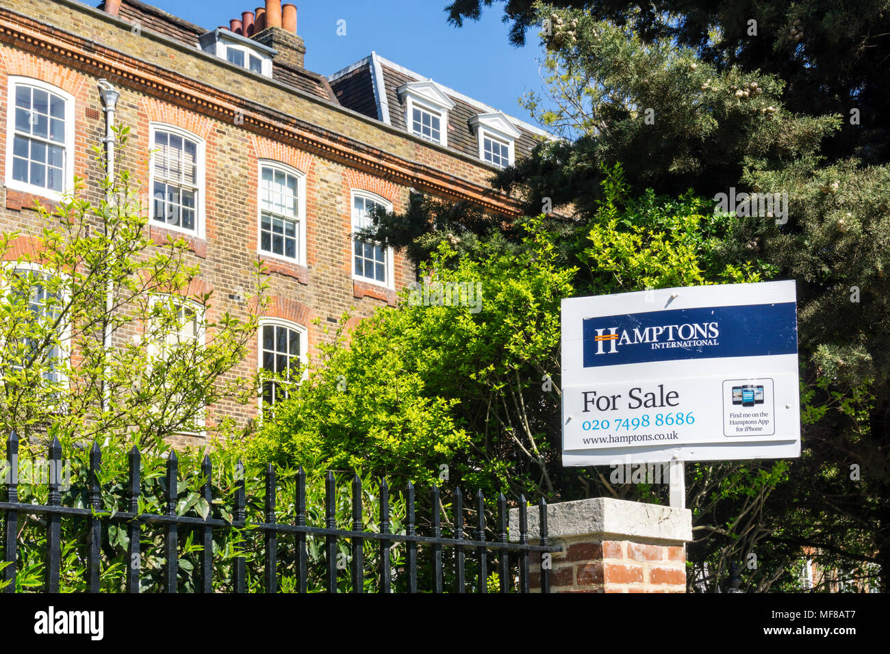 A Hamptons International Estate Agents For Sale Signboard Outside Homes On  Clapham Common North Side In Lambeth, South London