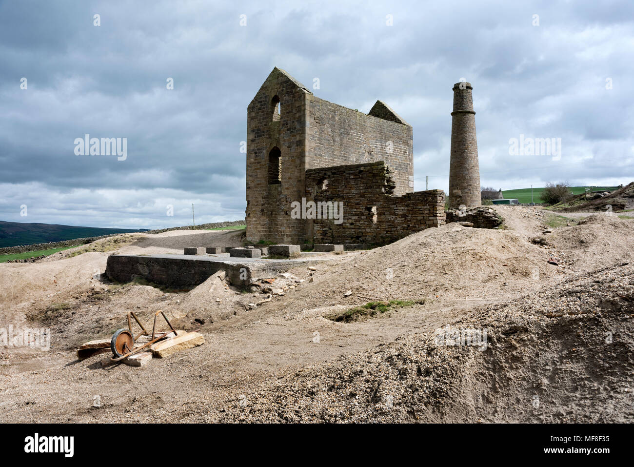 Cononley Lead Mine, near Skipton, North Yorkshire. Historic C19th lead mine with classic engine house, chimney and spoilt heaps. - Stock Image
