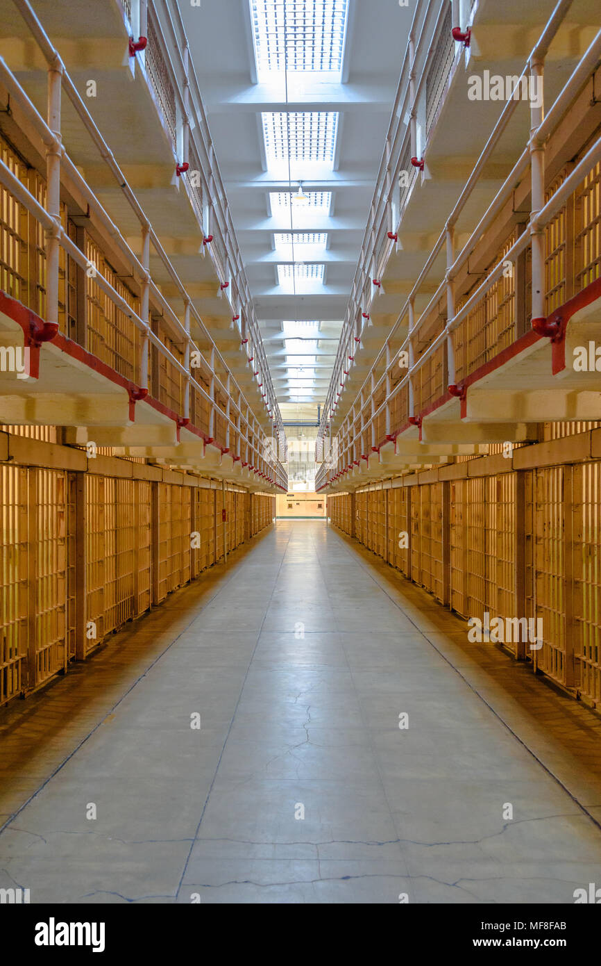 Looking down the central aisle of prison cells at Alcatraz - Stock Image