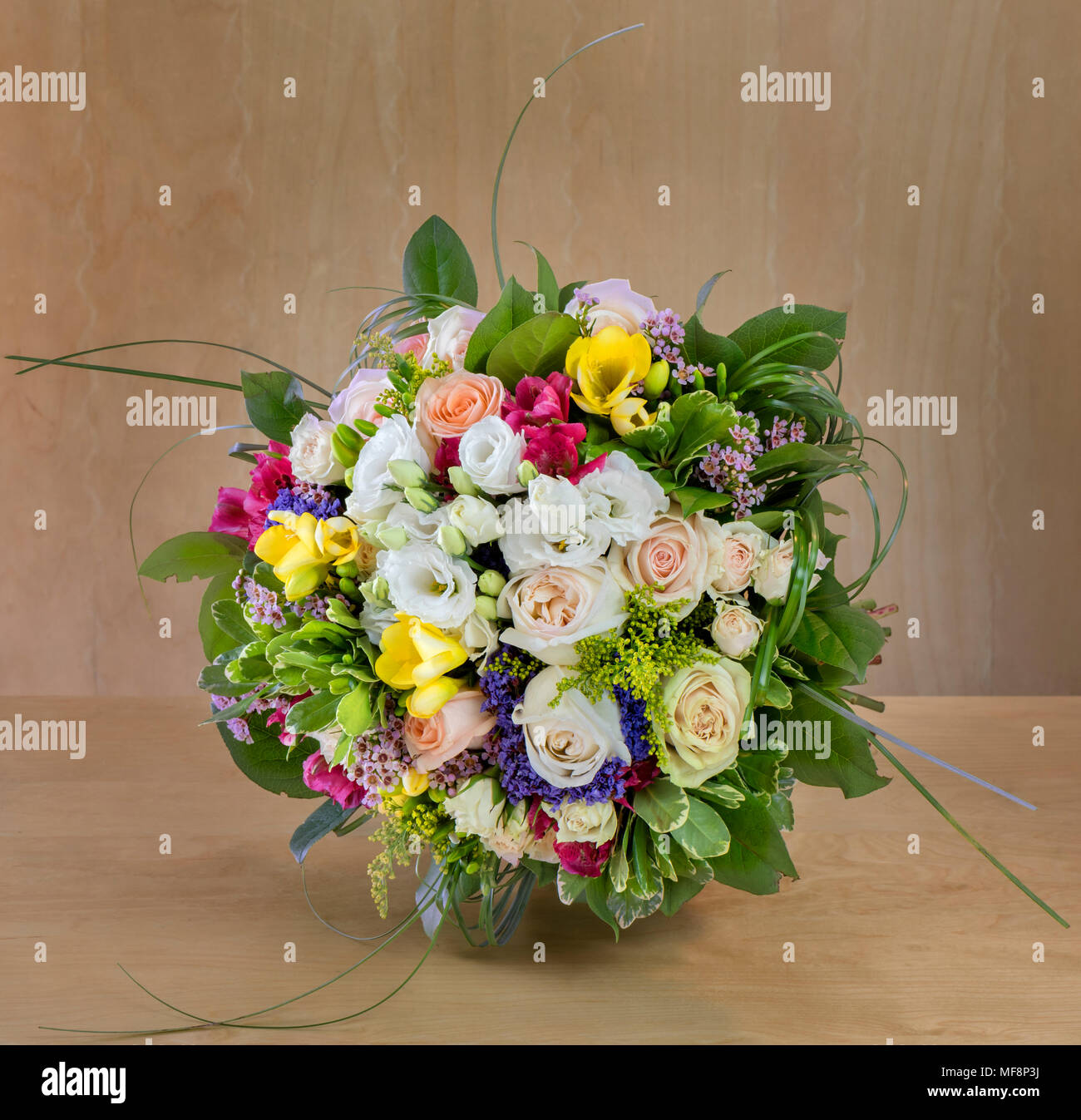 beautiful bouquet of flowers, multi-colored roses with green leaves ...