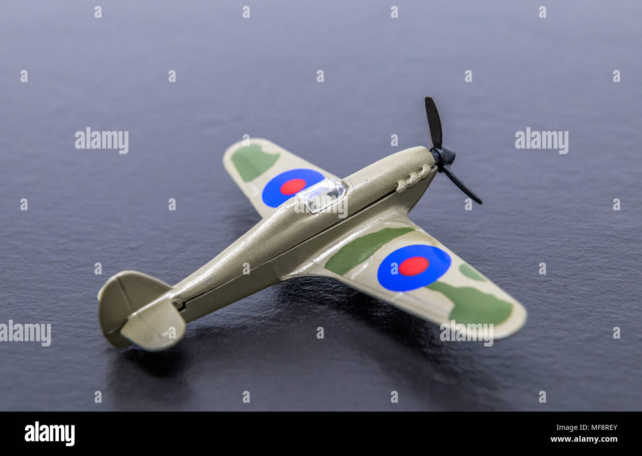 Miniture diecast replica of a second world war RAF Hurricane fighter. - Stock Image