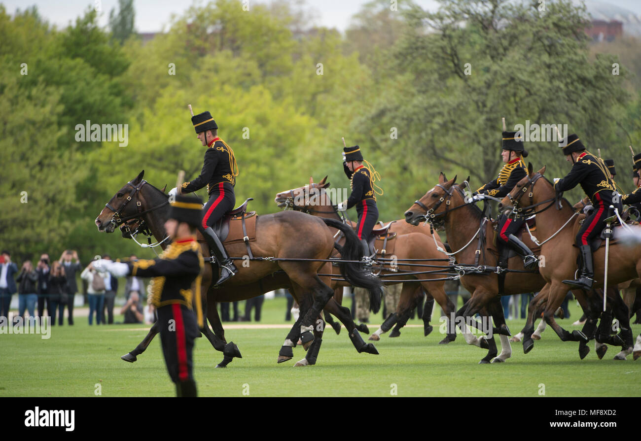 Hyde Park, London, UK. 24 April, 2018. The King's Troop Royal Horse Artillery fire celebratory Royal Salutes at 2pm on Tuesday 24th April to mark the birth of a new Royal baby, the Duke and Duchess of Cambridge's third child. 71 horses place six First World War era 13-pounder Field Guns into position for the Royal Salute halfway down Park Lane, blank artillery rounds are fired at ten-second intervals until forty-one shots have been fired. Credit: Malcolm Park/Alamy Live News. - Stock Image
