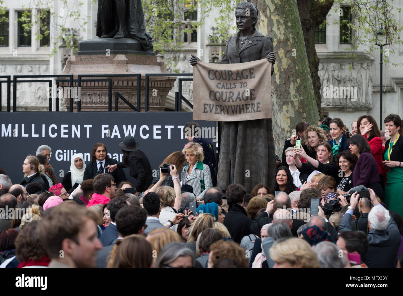 London, UK. 24th April, 2018. Unveiling ceremony of Millicent Fawcett statue in Parliament Square. The first statue of a woman in Parliament Square joins the line-up of male figures to mark the centenary of women's suffrage in Britain - two years after the campaign to get female representation outside the Palace of Westminster began. Credit: Guy Corbishley/Alamy Live News - Stock Image