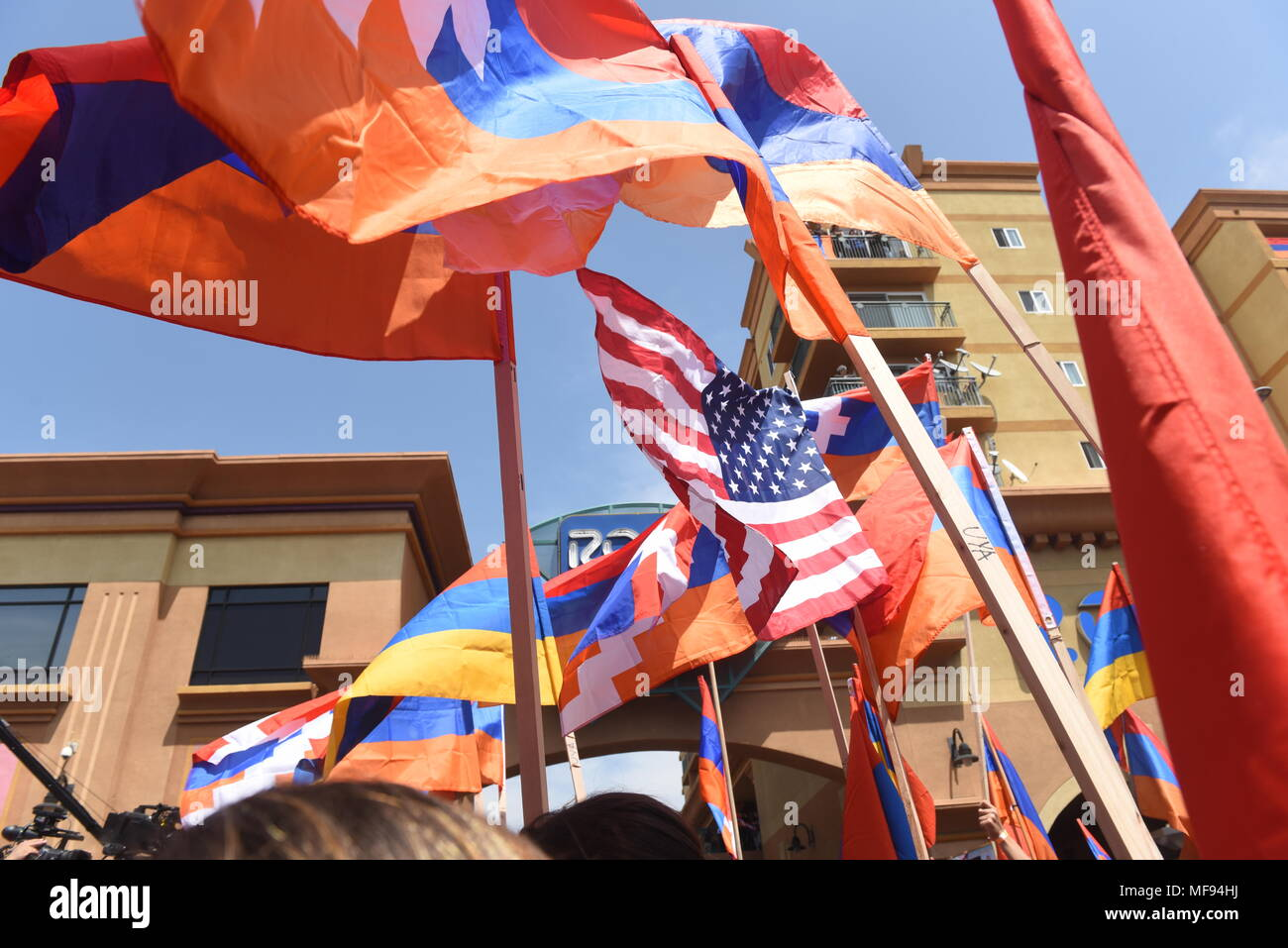 Los Angeles, USA. April 24, 2018 - LOS ANGELES - National flags of Armenia and USA during the 103rd anniversary commemoration of the Armenian Genocide on April 24. Little Armenia is a community that is part of the Hollywood district of Los Angeles, California. Credit: Hayk Shalunts/Alamy Live News - Stock Image