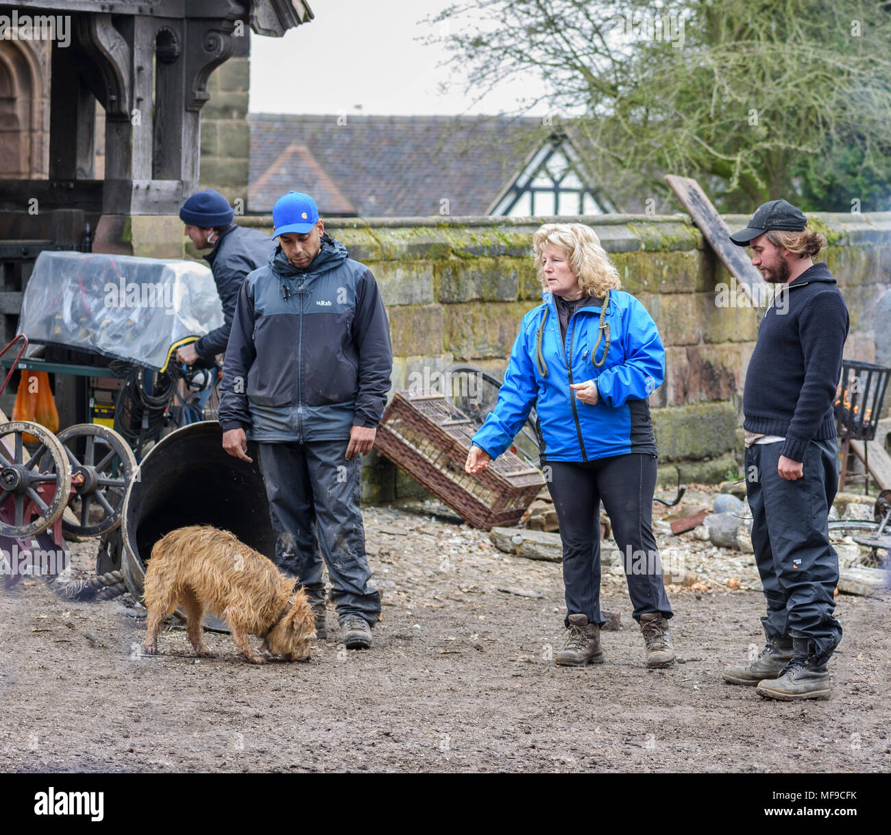 Great Budworth, UK. 11th April, 2018. Director Craig Viveiros and dog trainer preparing to shoot a scene on the set in the new BBC drama 'War Of The W - Stock Image