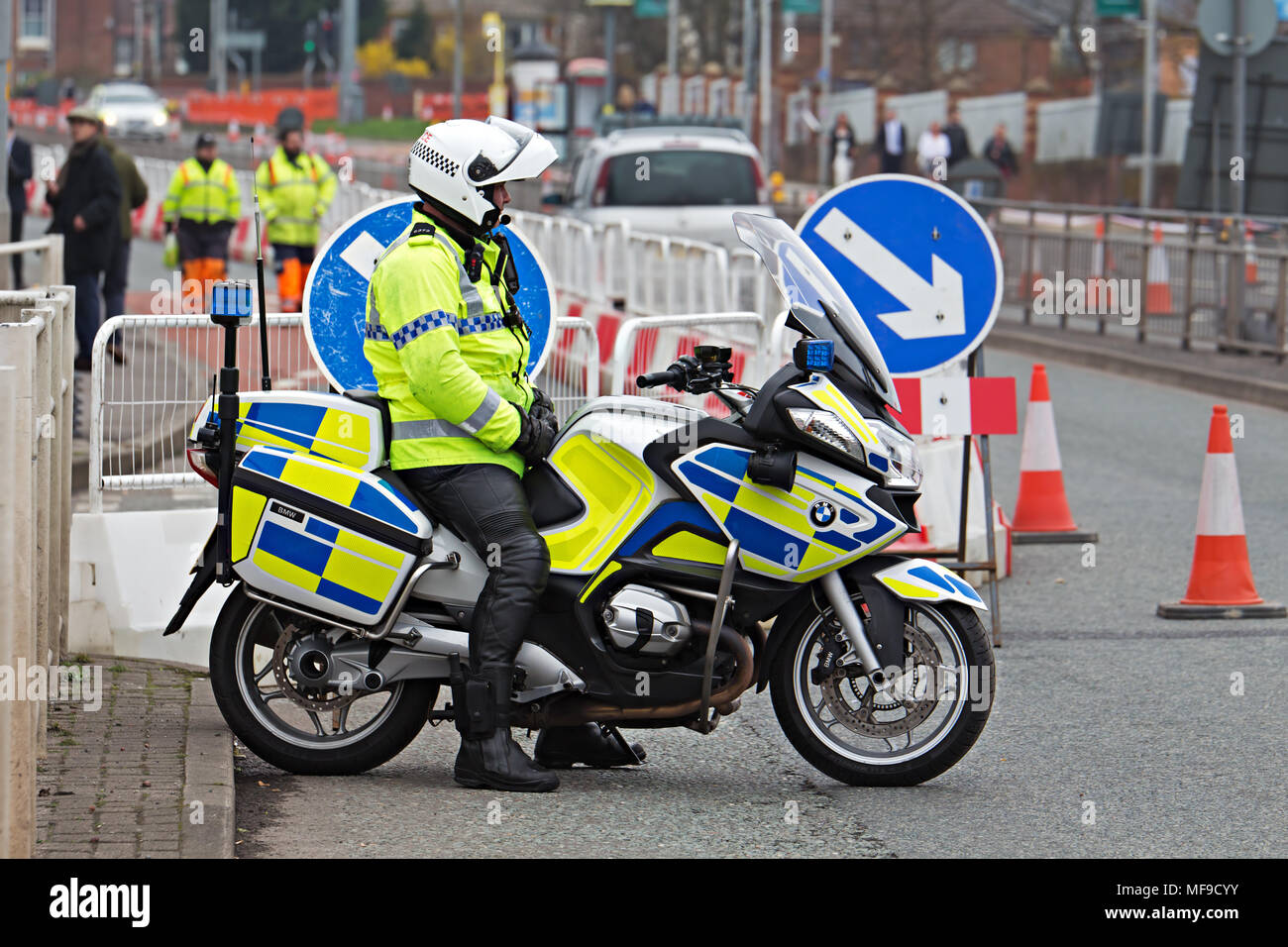 British motorcycle police officer on his BMW motorbike at the Grand National meeting in Liverpool 2018 - Stock Image