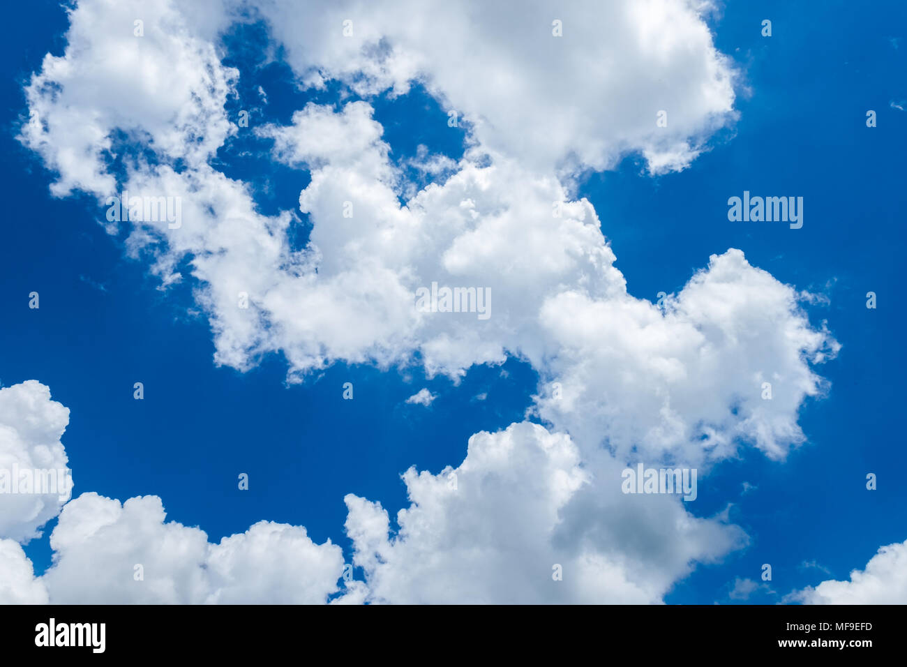 White cumulus clouds in deep blue sky. Cloudscape. Natural abstract background. - Stock Image