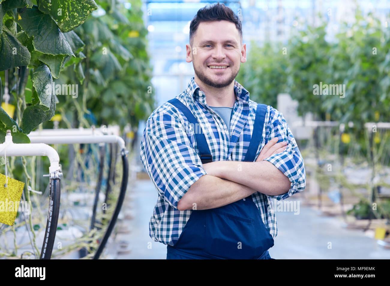 Smiling Worker on Vegetable Plantation - Stock Image