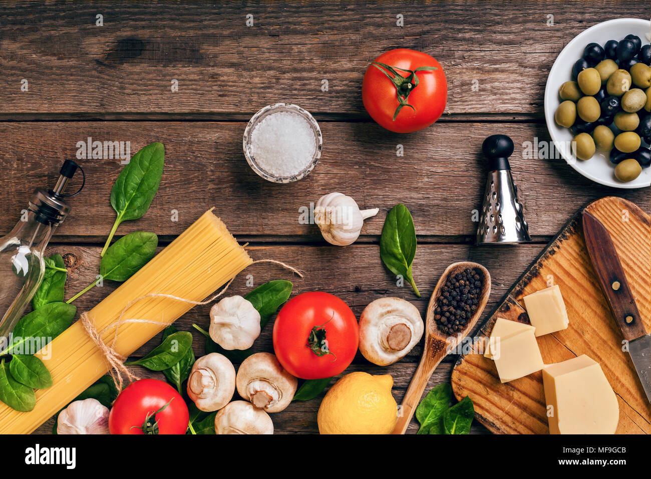 Italian food background with pasta, spices and vegetables. Top view, copy space. - Stock Image