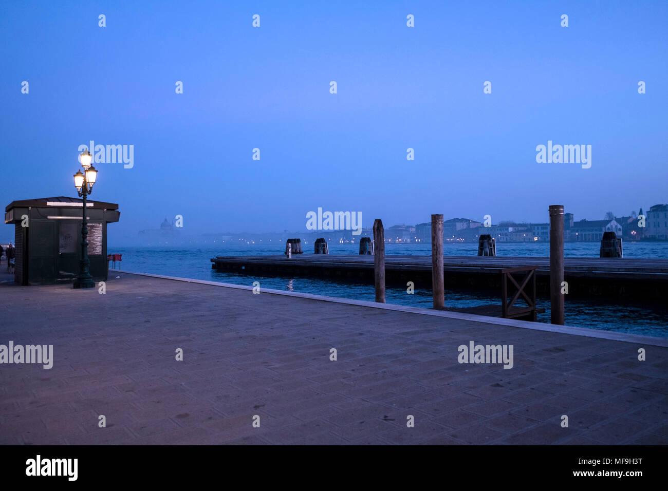Promenade along San Basilio in Venice, Italy, during blue hour Stock Photo