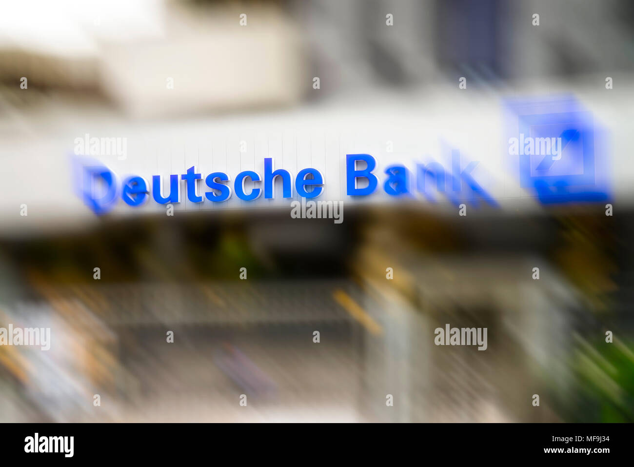 Logo of Deutsche Bank at the entrance of the Technology Center Eschborn (TZE) near Frankfurt with motion blur - Stock Image