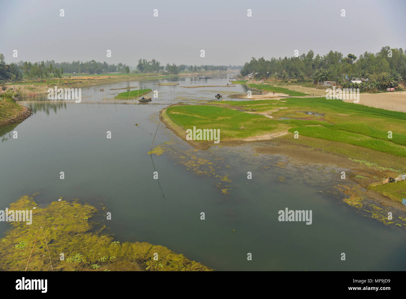 Bogra, Bangladesh - February 28, 2017: The Bangali River is embracing a slow death due to lack of dredging and/or as a consequence of human encroachme Stock Photo