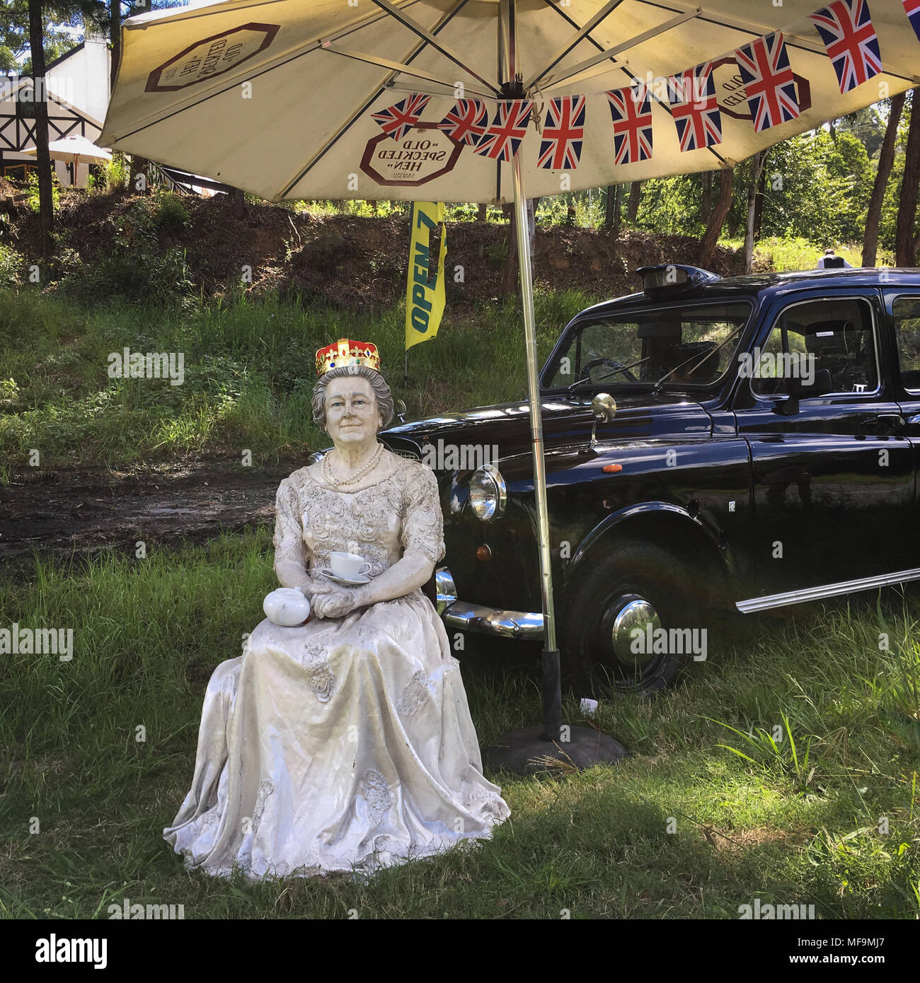 A model of Queen Elizabeth II, and a back London taxi, outside a pub in Australia, on 1 April 2018. Stock Photo