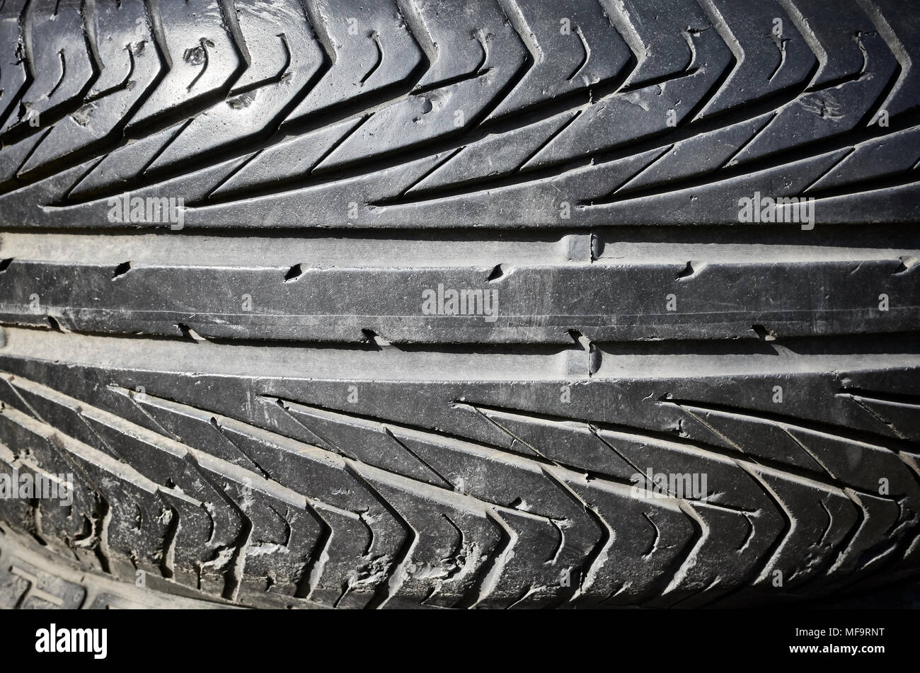 Close up picture of used black car tire. - Stock Image
