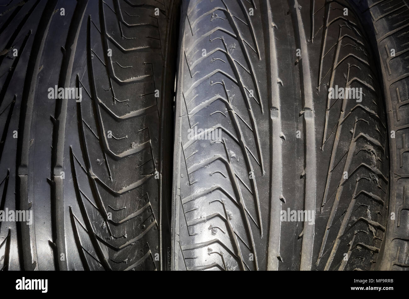 Close up picture of a used black car tires. - Stock Image