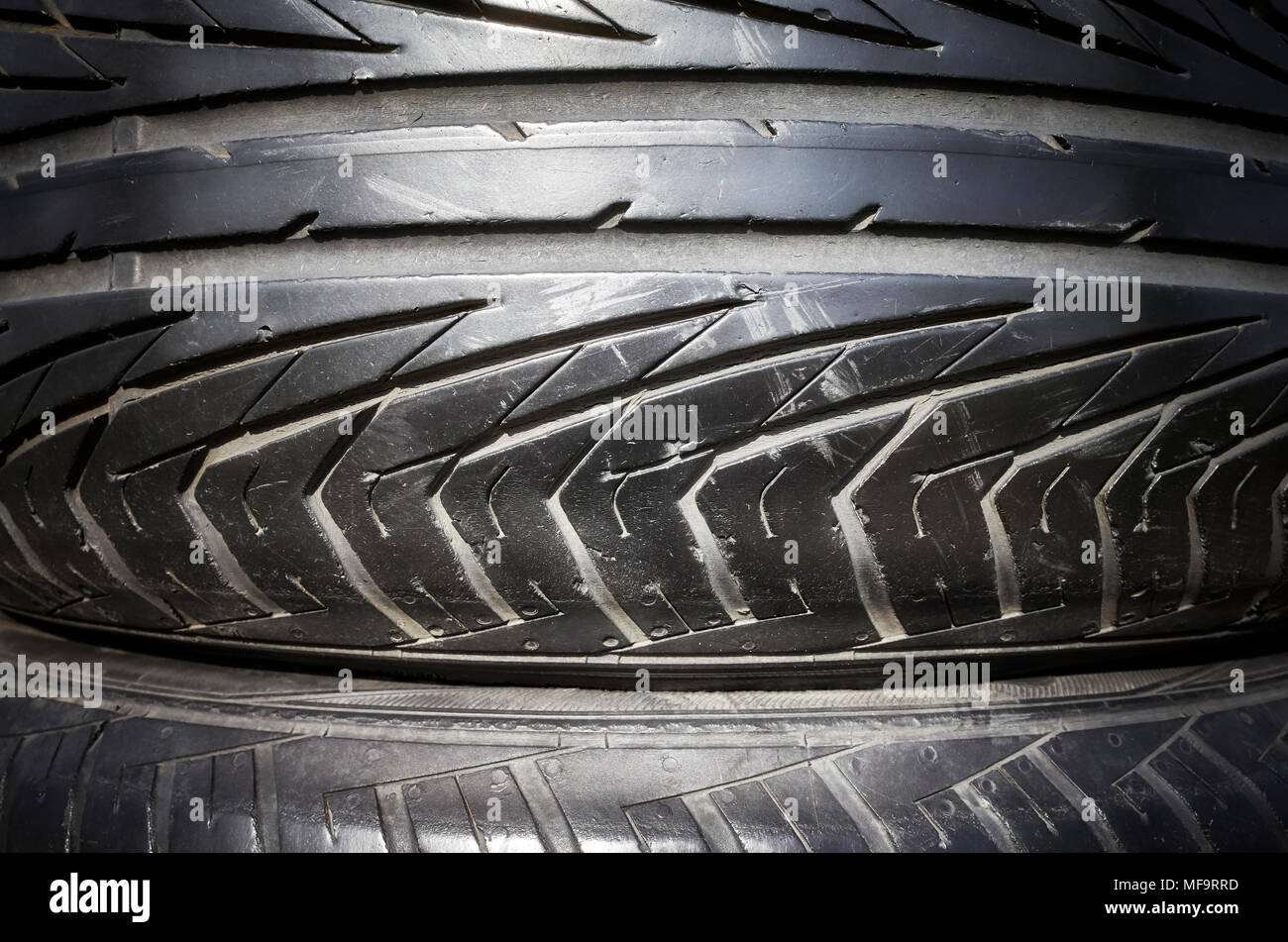 Close up picture of a used black car tire. - Stock Image