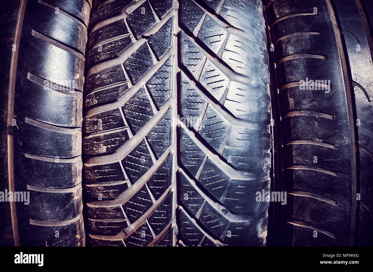 Vintage toned close up picture of used car tires. - Stock Image