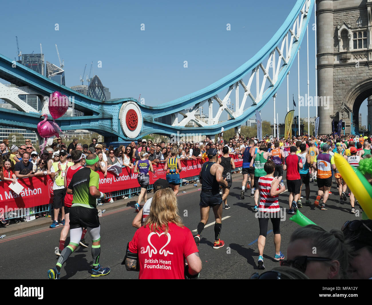 View of runners in the 2018 London Marathon crossing Tower Bridge Stock Photo