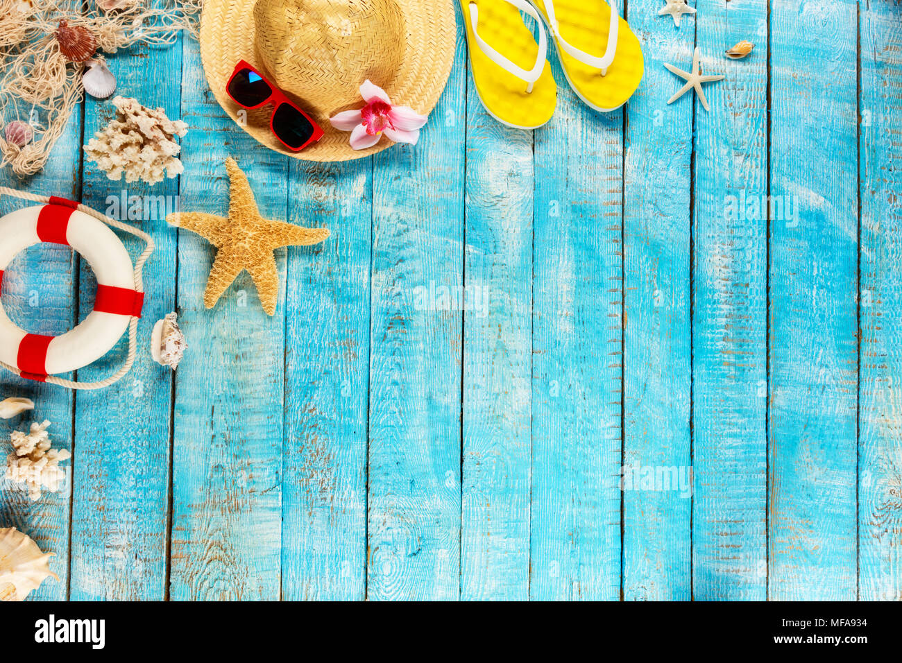 Beach Accessories Placed On Blue Wooden Planks Top View