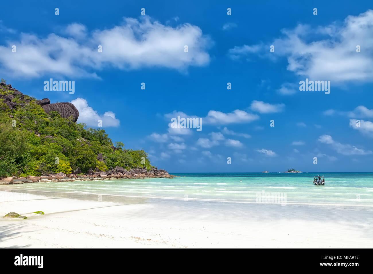 White coral sand on а tropical beach. Praslin island, Seychelles - Stock Image