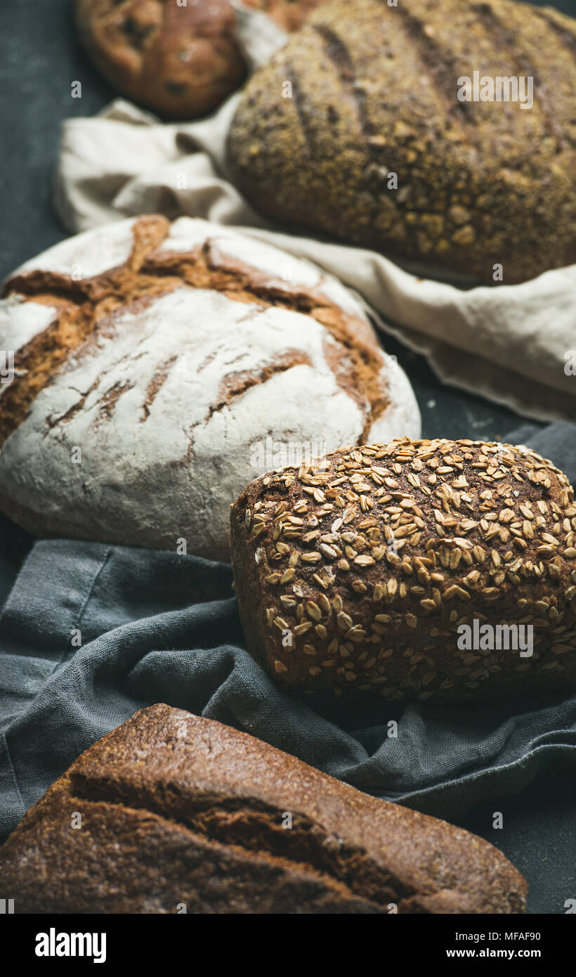 Close-up of Rye, wheat and multigrain rustic bread loaves - Stock Image