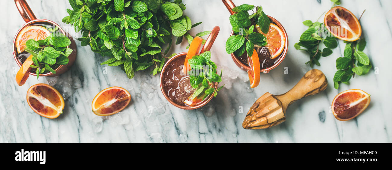 Blood orange Moscow mule alcohol cocktails, marble background, top view - Stock Image