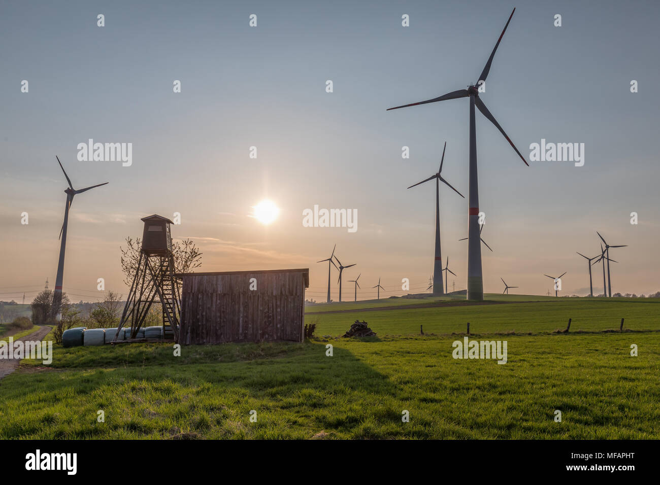cabin and wind farm - Stock Image