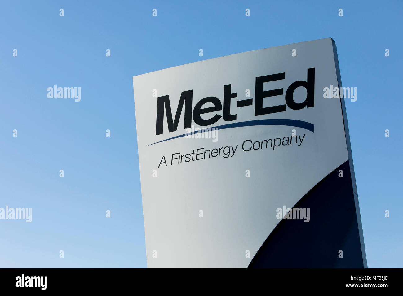 A logo sign outside of the headquarters of Met-Ed, a subsidiary of FirstEnergy, in Reading, Pennsylvania, on April 22, 2018. - Stock Image