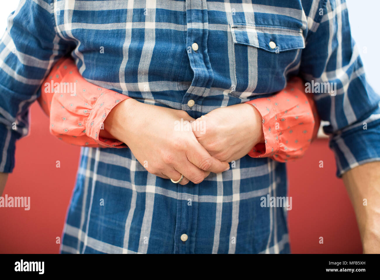 Close Up Of Woman Demonstrating Heimlich Maneuver In First Aid Class - Stock Image