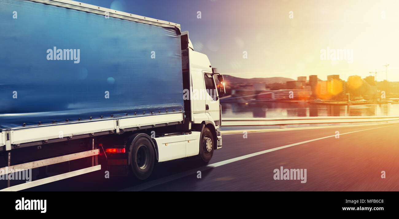 Truck run fast on the highway to deliver - Stock Image